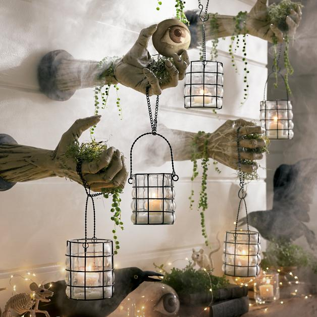 creepy hands with lanterns set of two grandin road
